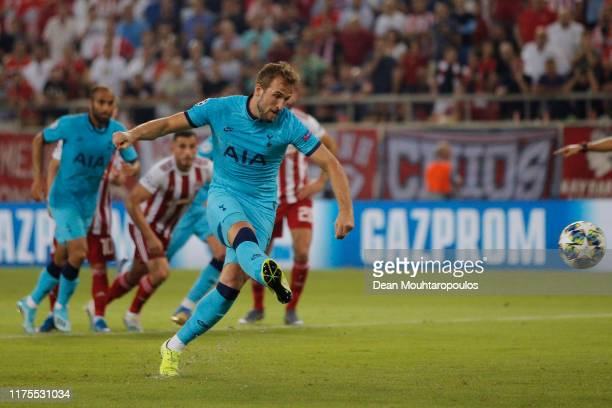 Harry Kane of Tottenham Hotspur scores his sides first goal from the penalty spot during the UEFA Champions League group B match between Olympiacos...