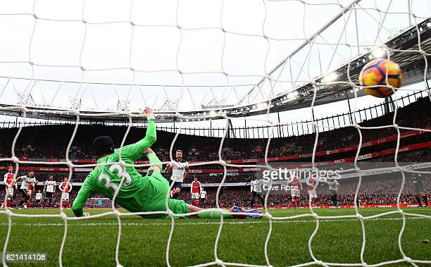 Harry Kane of Tottenham Hotspur scores his sides first goal from the penalty spot during the Premier League match between Arsenal and Tottenham...