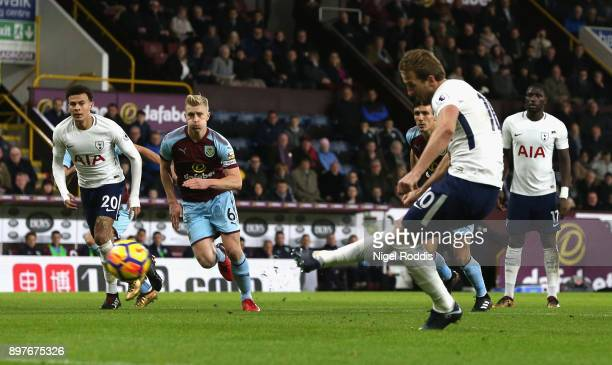 Harry Kane of Tottenham Hotspur scores his sides first goal from the penalty spot during the Premier League match between Burnley and Tottenham...