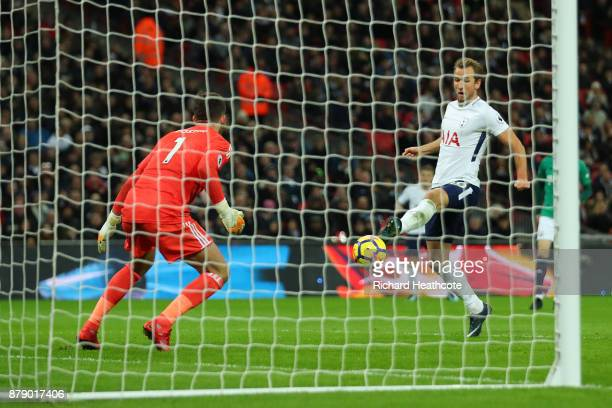 Harry Kane of Tottenham Hotspur scores his sides first goal past Ben Foster of West Bromwich Albion during the Premier League match between Tottenham...