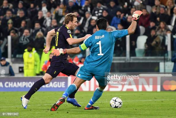 Harry Kane of Tottenham Hotspur scores his sides first goal past Gianluigi Buffon of Juventus during the UEFA Champions League Round of 16 First Leg...