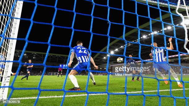 Harry Kane of Tottenham Hotspur scores his sides first goal past Mathew Ryan of Brighton and Hove Albion and Shane Duffy of Brighton and Hove Albion...
