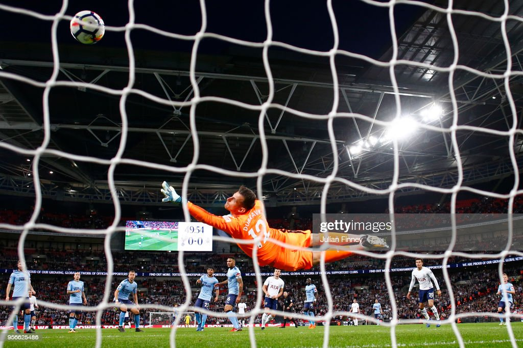 Harry Kane of Tottenham Hotspur scores his sides first goal past Martin Dubravka of Newcastle United during the Premier League match between Tottenham Hotspur and Newcastle United at Wembley Stadium on May 9, 2018 in London, England.