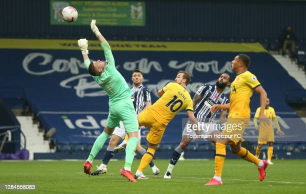 Harry Kane of Tottenham Hotspur scores his sides first goal past Sam Johnstone of West Bromwich Albion during the Premier League match between West...