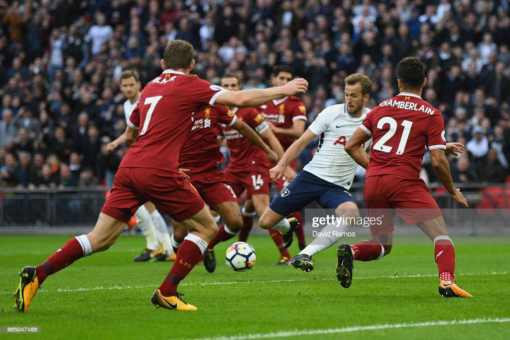 Harry Kane of Tottenham Hotspur scores his sides fourth goal during the Premier League match between Tottenham Hotspur and Liverpool at Wembley Stadium on October 22, 2017 in London, England.