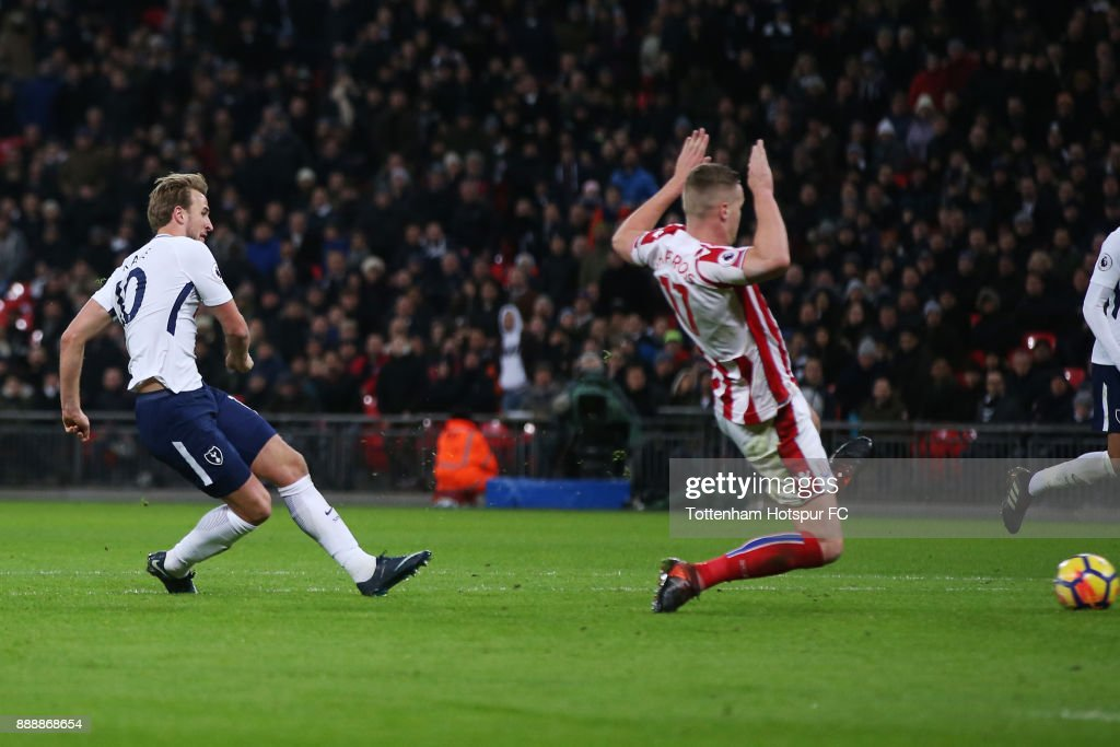 Harry Kane of Tottenham Hotspur scores his sides fourth goal during the Premier League match between Tottenham Hotspur and Stoke City at Wembley Stadium on December 9, 2017 in London, England.