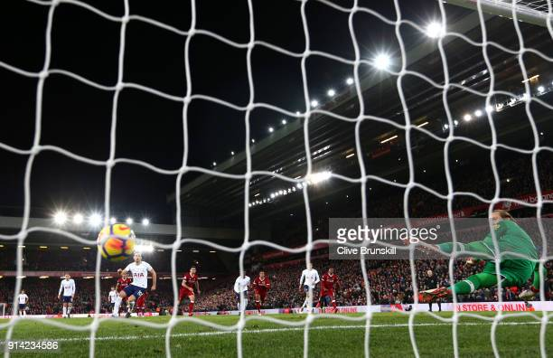 Harry Kane of Tottenham Hotspur scores his sides second goal and his 100th Premier League goal during the Premier League match between Liverpool and...