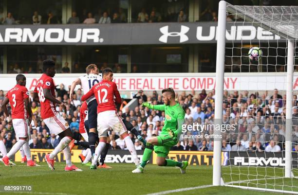 Harry Kane of Tottenham Hotspur scores his sides second goal past David De Gea of Manchester United during the Premier League match between Tottenham...