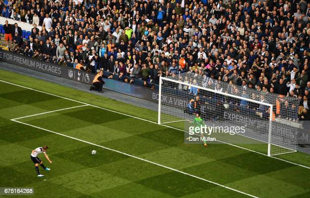 Harry Kane of Tottenham Hotspur scores his sides second goal past Petr Cech of Arsenal from the penalty spot during the Premier League match between...