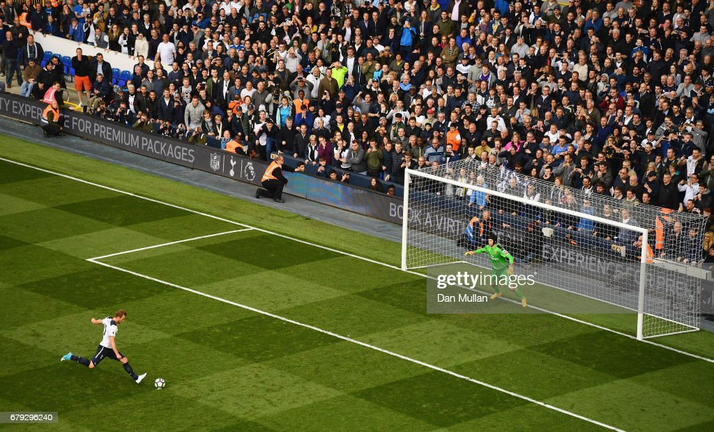 Harry Kane of Tottenham Hotspur scores his sides second goal past Petr Cech of Arsenal from the penalty spot during the Premier League match between Tottenham Hotspur and Arsenal at White Hart Lane on April 30, 2017 in London, England.