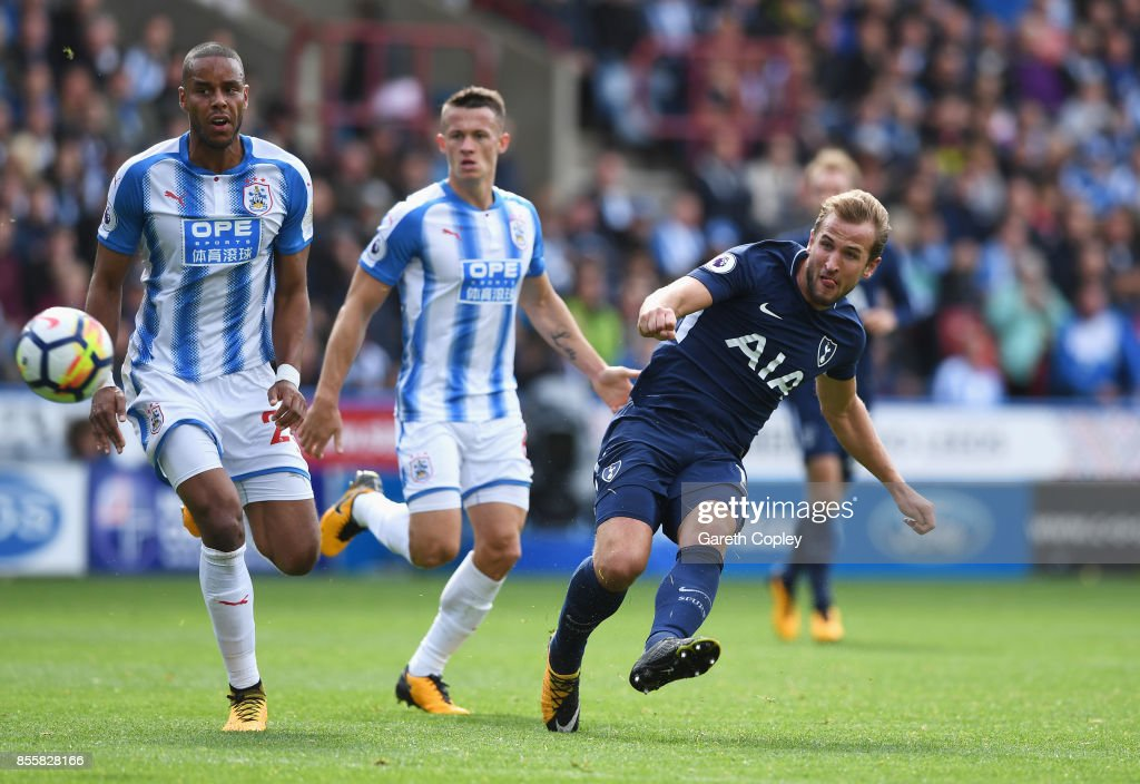 Harry Kane of Tottenham Hotspur scores his sides third goal during the Premier League match between Huddersfield Town and Tottenham Hotspur at John Smith's Stadium on September 30, 2017 in Huddersfield, England.