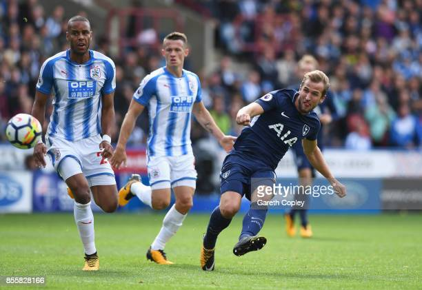 Harry Kane of Tottenham Hotspur scores his sides third goal during the Premier League match between Huddersfield Town and Tottenham Hotspur at John...