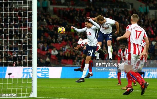 Harry Kane of Tottenham Hotspur scores his sides third goal during the Premier League match between Tottenham Hotspur and Stoke City at Wembley...