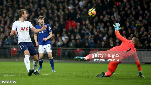 Harry Kane of Tottenham Hotspur scores his sides third goal during the Premier League match between Tottenham Hotspur and Everton at Wembley Stadium...