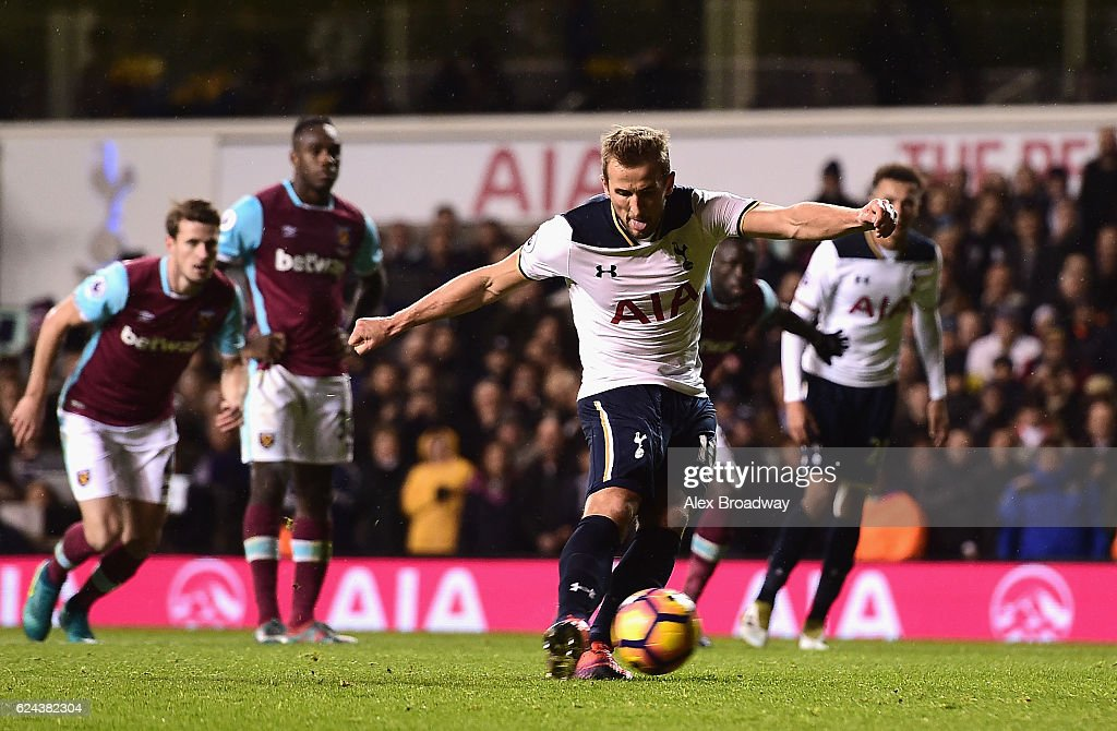 Harry Kane of Tottenham Hotspur scores his sides third goal from the penalty spot during the Premier League match between Tottenham Hotspur and West Ham United at White Hart Lane on November 19, 2016 in London, England.