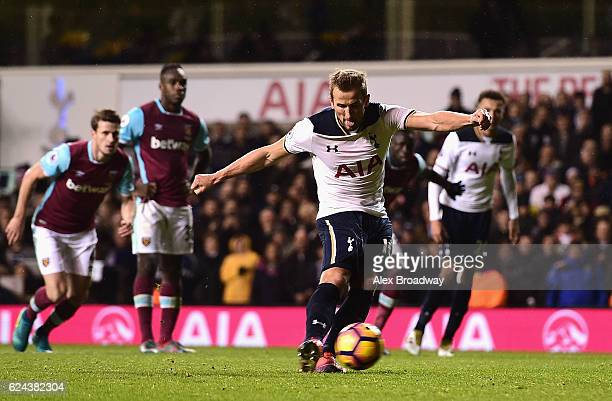 Harry Kane of Tottenham Hotspur scores his sides third goal from the penalty spot during the Premier League match between Tottenham Hotspur and West...