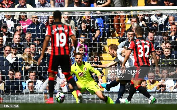 Harry Kane of Tottenham Hotspur scores his sides third goal past Artur Boruc of AFC Bournemouth during the Premier League match between Tottenham...