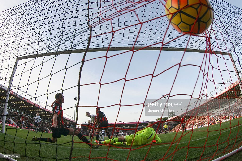 Harry Kane of Tottenham Hotspur scores his team's fifth and his hat trick goal past Artur Boruc of Bournemouth during the Barclays Premier League match between A.F.C. Bournemouth and Tottenham Hotspur at Vitality Stadium on October 25, 2015 in Bournemouth, England.