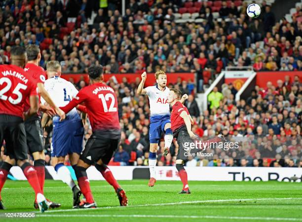 Harry Kane of Tottenham Hotspur scores his teams first goal during the Premier League match between Manchester United and Tottenham Hotspur at Old...