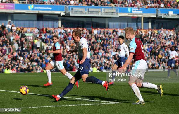 Harry Kane of Tottenham Hotspur scores his team's first goal during the Premier League match between Burnley FC and Tottenham Hotspur at Turf Moor on...