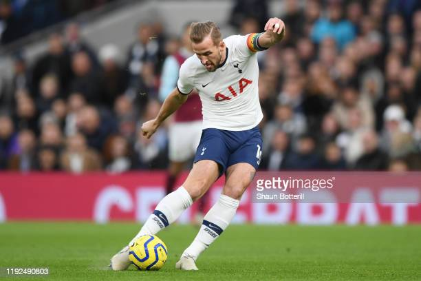 Harry Kane of Tottenham Hotspur scores his team's first goal during the Premier League match between Tottenham Hotspur and Burnley FC at Tottenham...