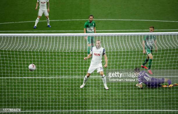 Harry Kane of Tottenham Hotspur scores his team's first goal during the UEFA Europa League playoff match between Tottenham Hotspur and Maccabi Haifa...