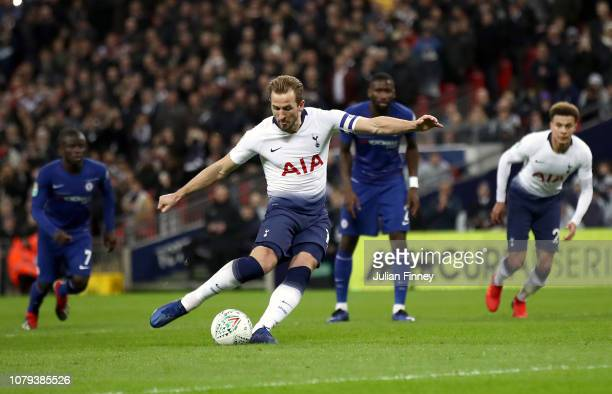 Harry Kane of Tottenham Hotspur scores his team's first goal from the penatly spot during the Carabao Cup SemiFinal First Leg match between Tottenham...