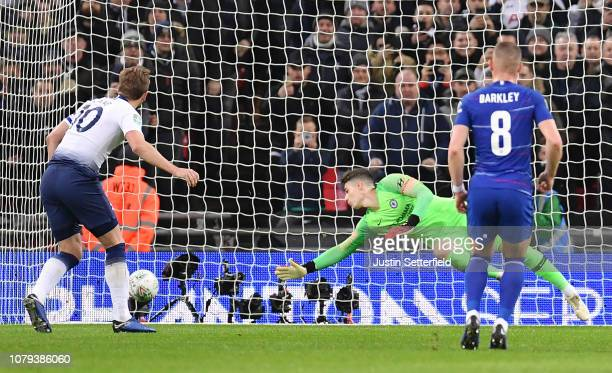 Harry Kane of Tottenham Hotspur scores his team's first goal from the penalty spot past Kepa Arrizabalaga of Chelsea during the Carabao Cup SemiFinal...
