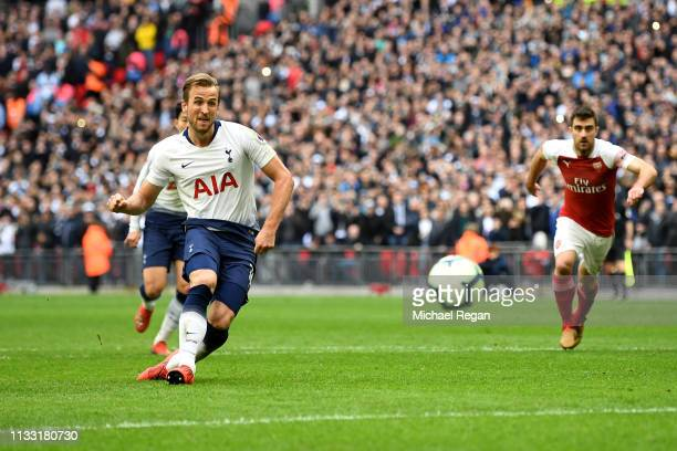 Harry Kane of Tottenham Hotspur scores his team's first goal from the penalty spot during the Premier League match between Tottenham Hotspur and...