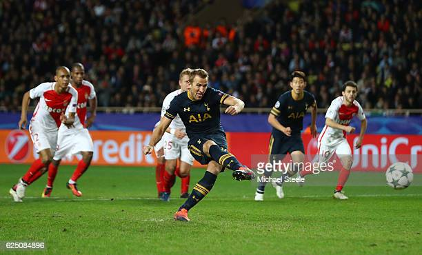 Harry Kane of Tottenham Hotspur scores his teams first goal from the spot during the UEFA Champions League Group E match between AS Monaco FC and...