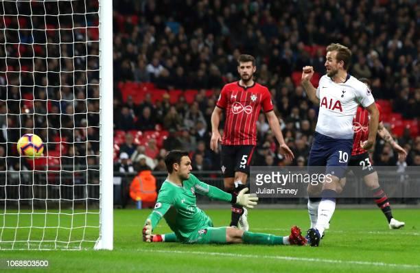 Harry Kane of Tottenham Hotspur scores his team's first goal past Alex McCarthy of Southampton during the Premier League match between Tottenham...