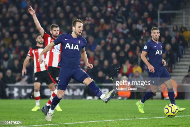 Harry Kane of Tottenham Hotspur scores his team's first goal which is then disallowed for offside by VAR during the Premier League match between...