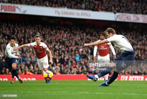 Harry Kane of Tottenham Hotspur scores his team's second goal during the Premier League match between Arsenal FC and Tottenham Hotspur at Emirates...