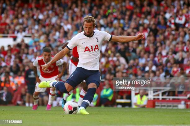 Harry Kane of Tottenham Hotspur scores his team's second goal from the penalty spot during the Premier League match between Arsenal FC and Tottenham...
