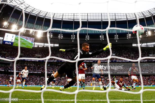 Harry Kane of Tottenham Hotspur scores his team's second goal past Tom Heaton of Aston Villa during the Premier League match between Tottenham...