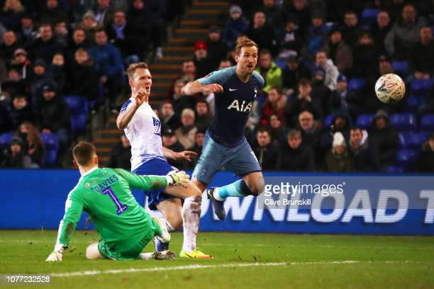 Harry Kane of Tottenham Hotspur scores his team's seventh goal past Scott Davies of Tranmere Rovers during the FA Cup Third Round match between...