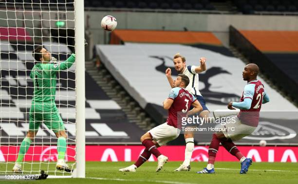 Harry Kane of Tottenham Hotspur scores his team's third goal during the Premier League match between Tottenham Hotspur and West Ham United at...