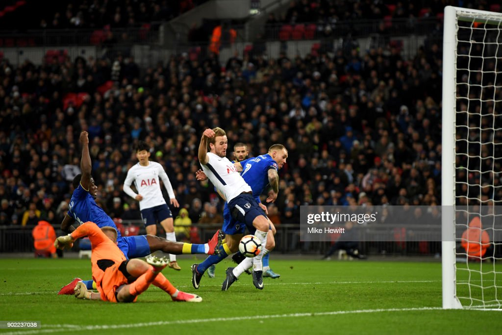 Harry Kane of Tottenham Hotspur scores the opening goal during The Emirates FA Cup Third Round match between Tottenham Hotspur and AFC Wimbledon at Wembley Stadium on January 7, 2018 in London, England.