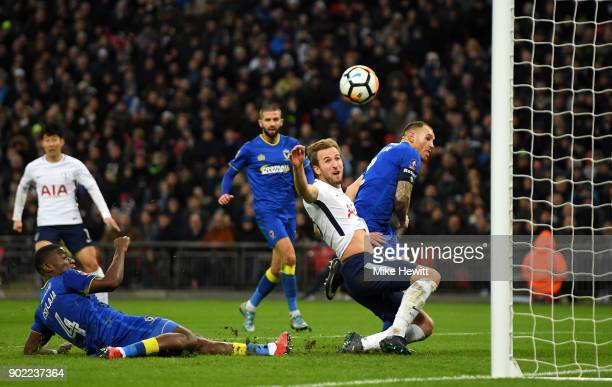 Harry Kane of Tottenham Hotspur scores the opening goal during The Emirates FA Cup Third Round match between Tottenham Hotspur and AFC Wimbledon at...