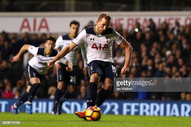 Harry Kane of Tottenham Hotspur scores the opening goal from the penalty spot during the Premier League match between Tottenham Hotspur and...