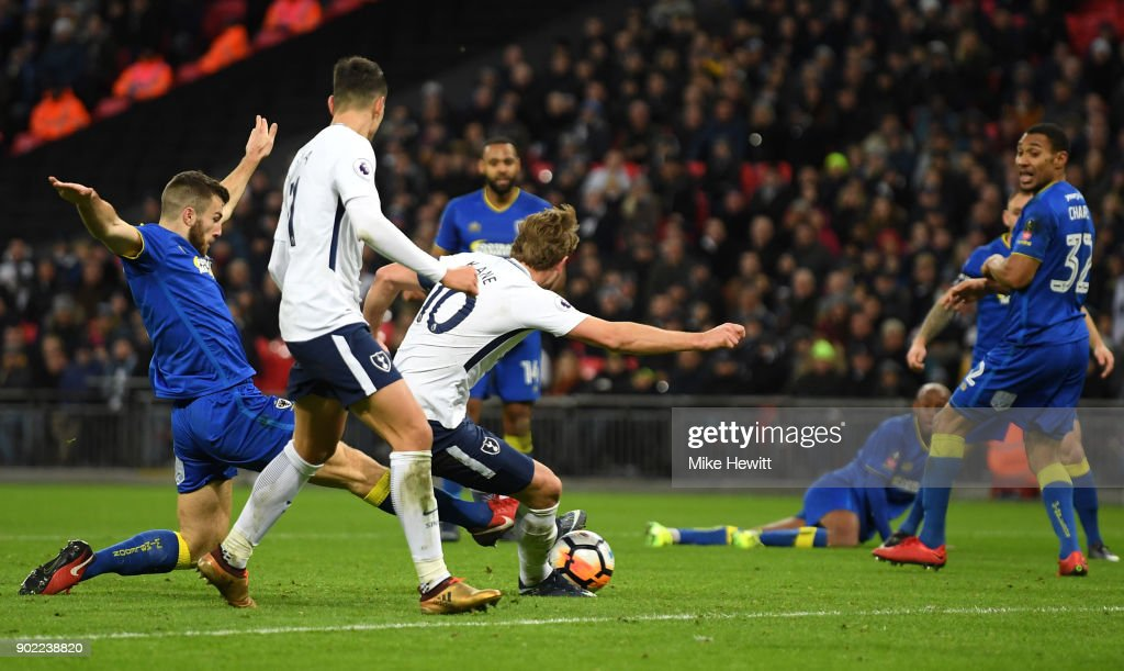 Harry Kane of Tottenham Hotspur scores the second goal during The Emirates FA Cup Third Round match between Tottenham Hotspur and AFC Wimbledon at Wembley Stadium on January 7, 2018 in London, England.
