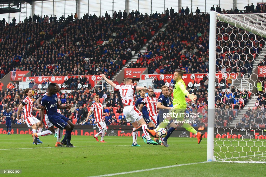 Harry Kane of Tottenham Hotspur scores their 2nd goal during the Premier League match between Stoke City and Tottenham Hotspur at Bet365 Stadium on April 7, 2018 in Stoke on Trent, England.
