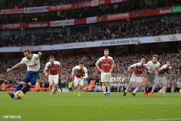 Harry Kane of Tottenham Hotspur scores their 2nd goal from the penalty spot during the Premier League match between Arsenal FC and Tottenham Hotspur...