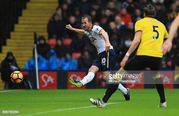 Harry Kane of Tottenham Hotspur scores their first goal during the Premier League match between Watford and Tottenham Hotspur at Vicarage Road on...