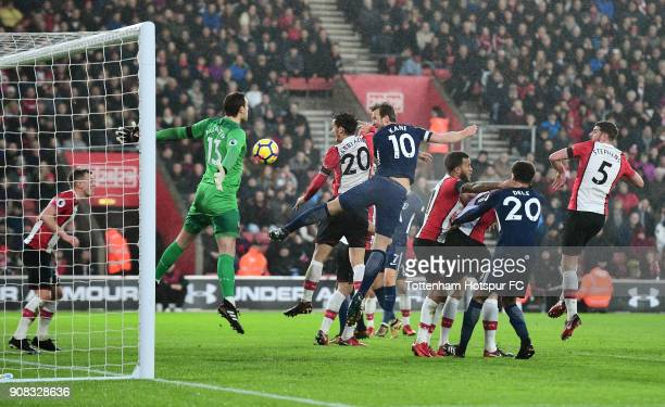 Harry Kane of Tottenham Hotspur scores their first goal past Alex McCarthy of Southampton during the Premier League match between Southampton and...