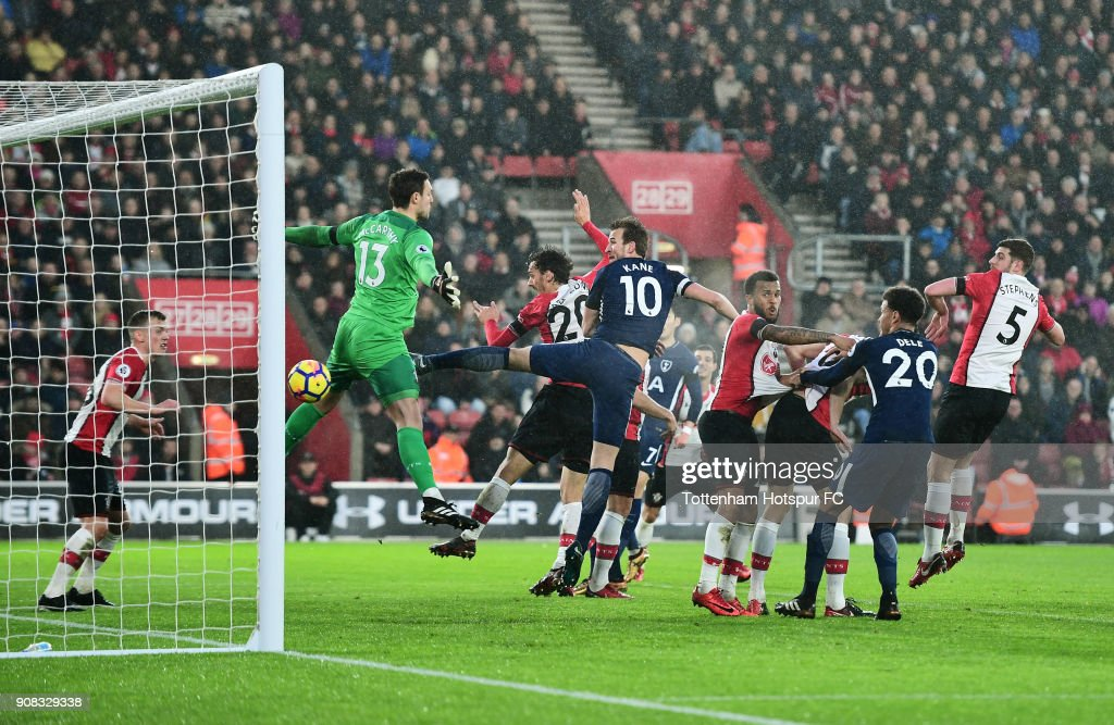 Harry Kane of Tottenham Hotspur (10) scores their first goal past Alex McCarthy of Southampton (13) during the Premier League match between Southampton and Tottenham Hotspur at St Mary's Stadium on January 21, 2018 in Southampton, England.