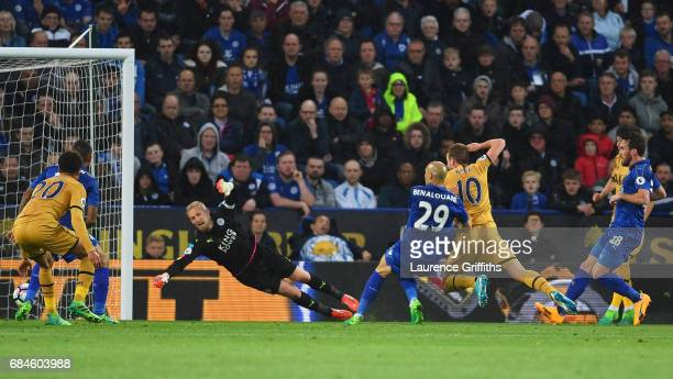 Harry Kane of Tottenham Hotspur scores their first goal past goalkeeper Kasper Schmeichel of Leicester City during the Premier League match between...