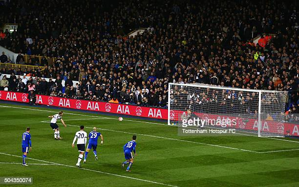 Harry Kane of Tottenham Hotspur scores their second goal from the penalty spot past goalkeeper Kasper Schmeichel of Leicester City during the...