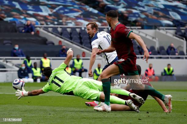 Harry Kane of Tottenham Hotspur scores their side's first goal past Rui Patricio of Wolverhampton Wanderers during the Premier League match between...