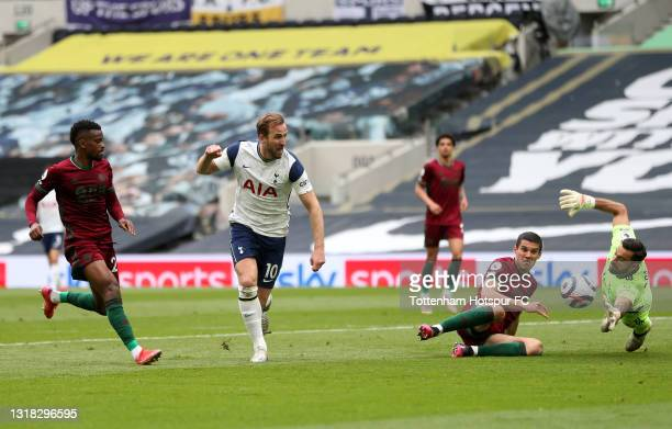 Harry Kane of Tottenham Hotspur scores their side's first goal past Rui Patricio of Wolverhampton Wanderers whilst under pressure from Conor Coady of...